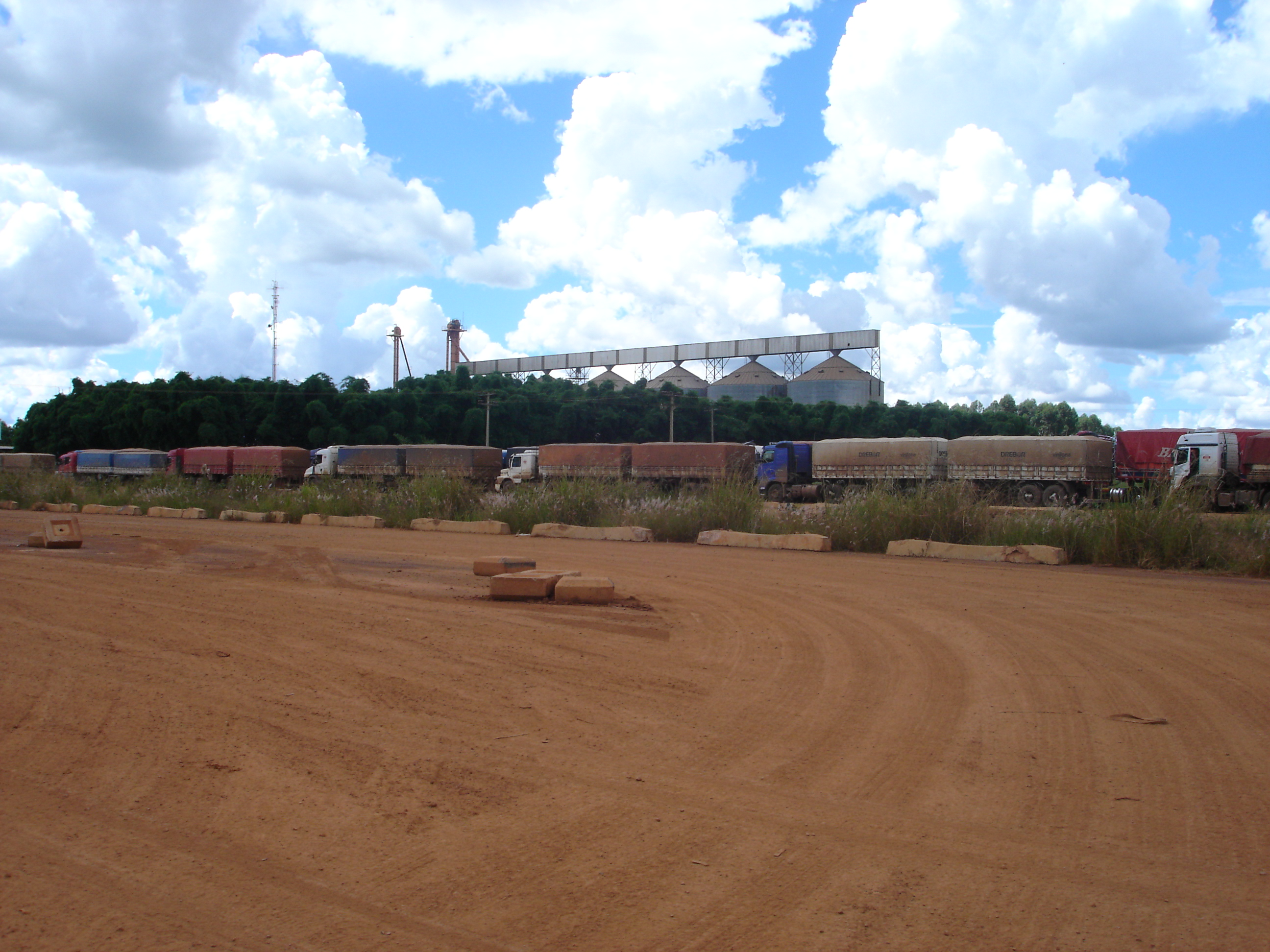 Trucks waiting to unload soybeans at Ferronorte Railroad in Alto Taquari, Mato Grosso